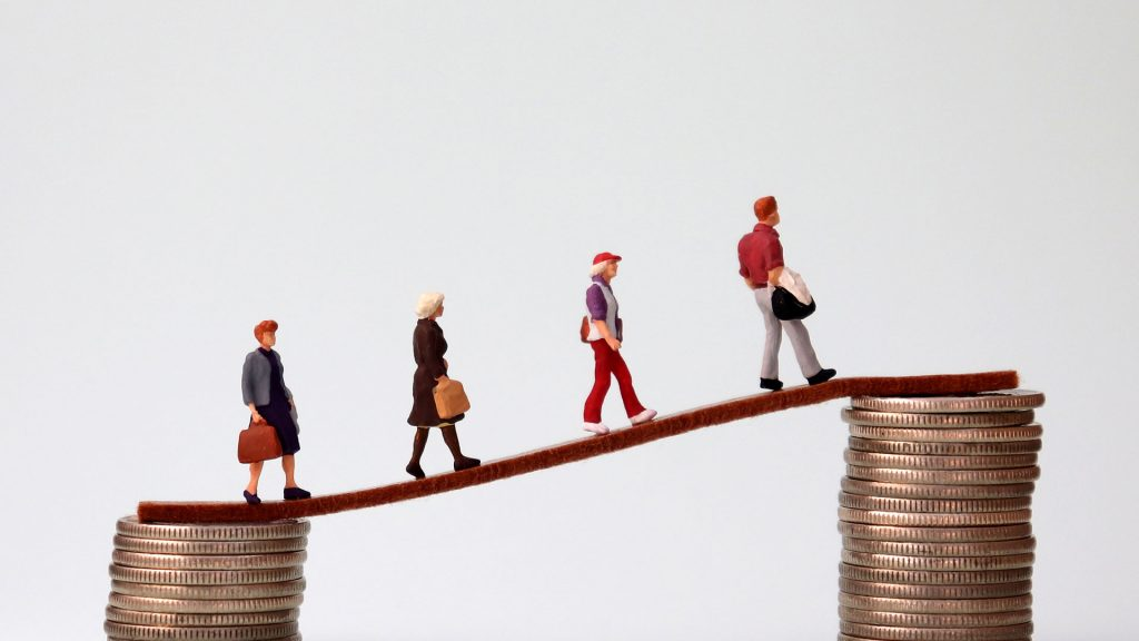 Image of figures representing therapists and mental health counselors walking across a bridge between two stacks of coins representing their movement from a lower salary to a higher salary.
