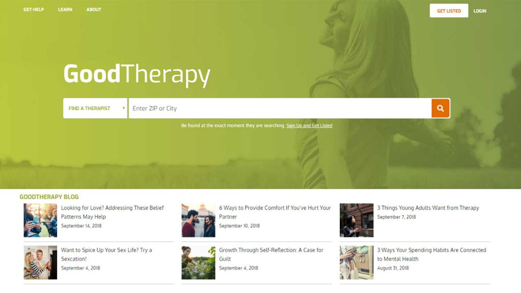 The Good Therapy website homepage where users can search for therapists in their area features a smiling woman in a field above a series of blog posts by the GoodTherapy team.
